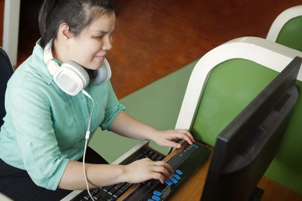 Blind person using computer.